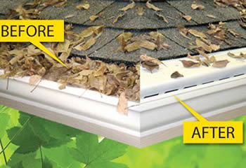 White PVC snap in gutter is installed on the roof and with several colorful leaves on it.