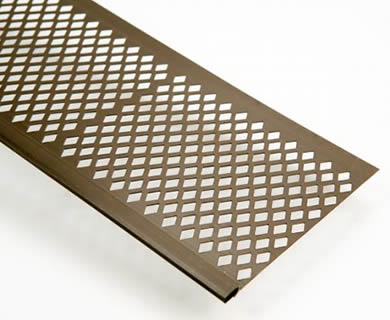 A half of piece of brown diamond gutter screen lay inclined on the white background.
