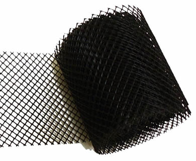 A roll of black plastic gutter mesh on the white background, the beginning is unfolded and the other is rolled.