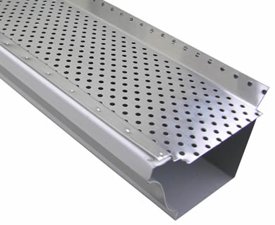 The mill finish aluminum gutter guard fastened on K style gutter lays inclined on the white background.