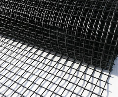 A roll of black square plastic gutter mesh on the white background.
