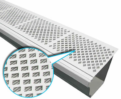 A piece of white diamond gutter screen with fine mesh lay inclined on the white background.